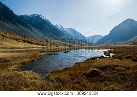 Beautiful Lake On A Clear Autumn Day Against The Background Of Mountains, Altai