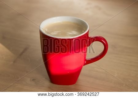 Two Cups Yellow And Red Of Cappuccino With Latte Art On Wooden Background. Beautiful Foam, Greenery