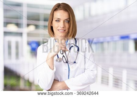 Confident Female Doctor Portrait While Standing In The Hospital Corridor