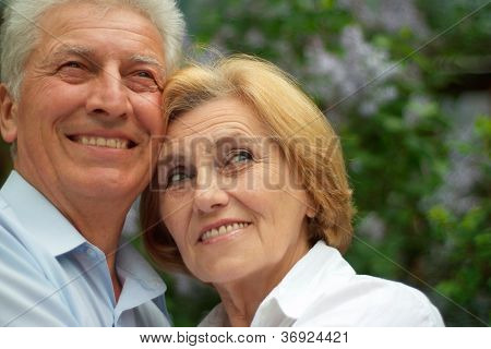 Smiling couple enjoy union with nature