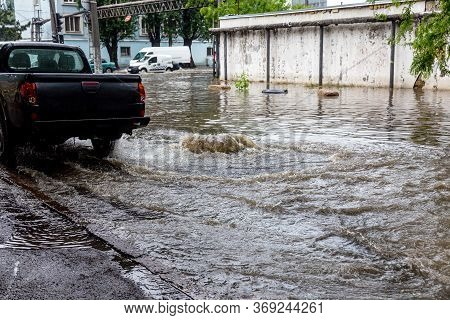 Вriving Car On Flooded Road During Flood Caused By Torrential Rains. Cars Float On Water, Flooding S