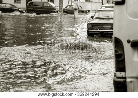 Flooding After Heavy Rains In City. Sewage Broke Open Asphalt And Blew Up Fountain. Dirty Sewage Bro