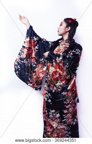 Young Pretty Geisha In Black Kimono With Sakura, Asian Ethno Closeup On White Background Isolated
