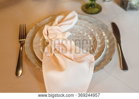 Top View Festive Table Setting With Green Wine Glasses And Plate