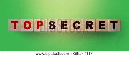 Words Top Secret On Wooden Cubes On Green Background. Trading Or Big Profit Secrets Business Concept