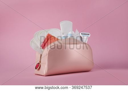 Hygiene Feminine Pads, Tampon And Female Razor In The Cosmetic Bag On Pink Background. Menstrual Cyc