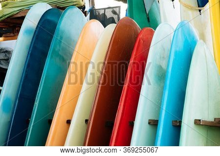 Set Of Colorful Surfboard For Rent On The Beach. Multicolored Blue, Red, White Surf Boards Different