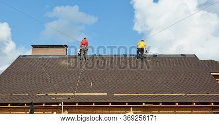 Kyiv, Ukraine - June, 14, 2020: Roofing Contractors With Fall Protection, Roof Safety Harness, Ropes