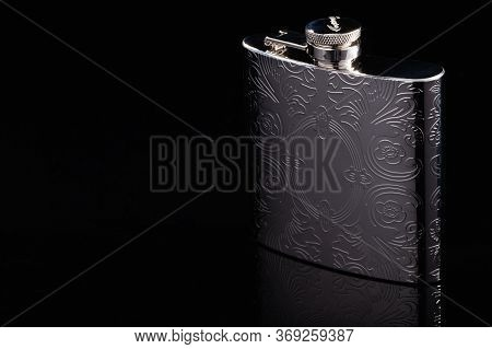 Prague, Czech Republic - 15 May,2020: Stainless Hip Flask On The Black Glass Table. Flask For Alcoho