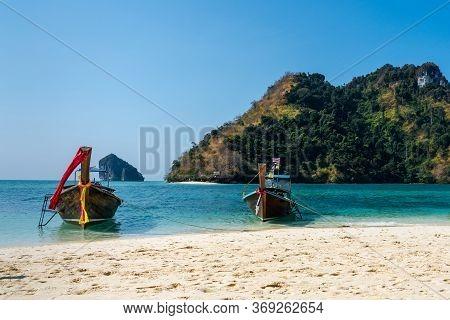 Three Long Tail Boats Off Koh Poda In Krabi Thailand