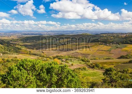 Beautiful Autumn Landscape In Tuscany, Italy. Panorama Of The Dorca Valley, Golden Grapes, Blue Sky