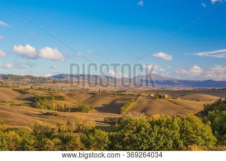 Golden Autumn In The D'orcia Valley. Beautiful Landscape With Hills And Blue Sky In Tuscany, Italy.