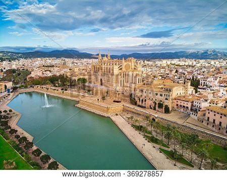 Aerial Drone View Palma De Mallorca Cathedral Was Built On A Cliff Rising Out Of The Sea. Picturesqu