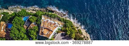 Panoramic View Directly From Above Coast And Mediterranean Sea. Summer Luxury Villas With Swimming P