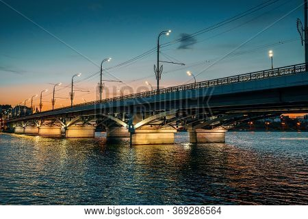 Voronezh At Night Cityscape With Chernyavsky Bridge Over River With Illumination In Water.