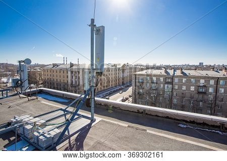Russia, Saint-petersburg - April 30, 2018: Panel Antenna Of 5g, 4g, 3g, 2g Bands, Optical Fibers, Po