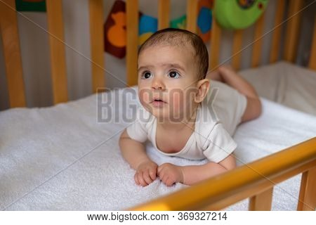 Newborn Baby. A Little Boy In White Clothes. Beautiful Portrait Of A Toddler. Big-eyed Baby. Baby In