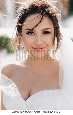 Portrait Of The Bride In Close-up.a Stunning Young Bride With Curly Hair . Wedding Day. . Beautiful
