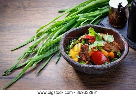 Wok Duck Meat With Vegetables In A Bowl On Wooden Table Background. Asian Wok With Duck, Bell Pepper