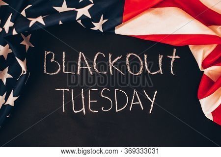 Blackout Tuesday Inscription On A Black Background With American Flag Around. Black Lives Matter, Bl