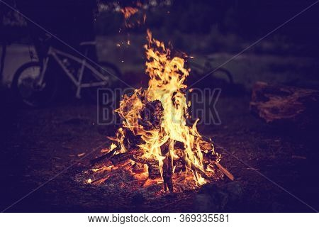 Campfire And Bicycles In The Background. Image For Design