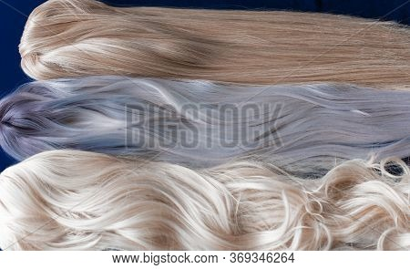 Wigs Synthetic And Natural Hair. Blonde And Ash Blonde Hair. Womens Beauty Concept