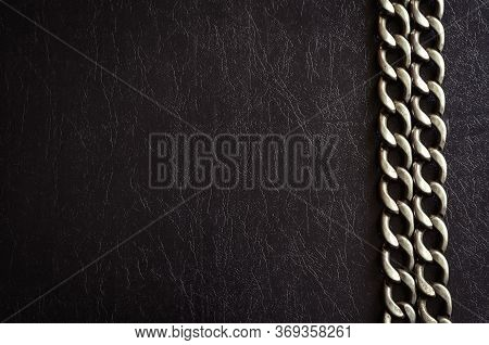 Metal Chain On A Dark Background. Two Rows Of Wicker Chain On A Textured Background. Copy Space. Mul
