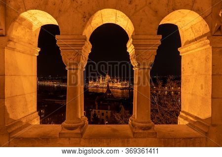 Night View Of Hungarian Parliament From Fisherman Bastion On Top Of Buda Hill In Budapest