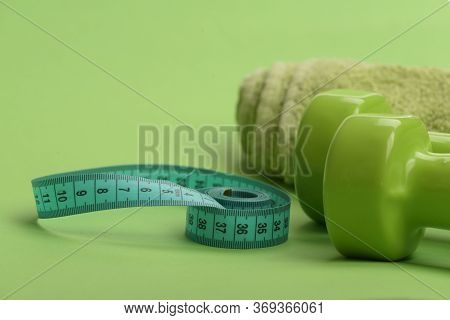 Healthy Regime Equipment. Dumbbells In Green Color, Twisted Measure Tape