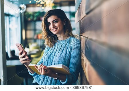 Female Student Spending Time At Campus Talking Via Mobile Phone With 4g Internet
