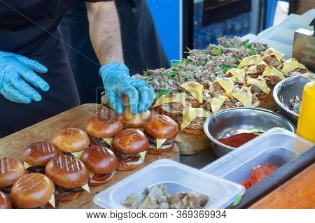 Street Fast Food. Cooks Prepare Different Burgers In Outdoors Cafe.