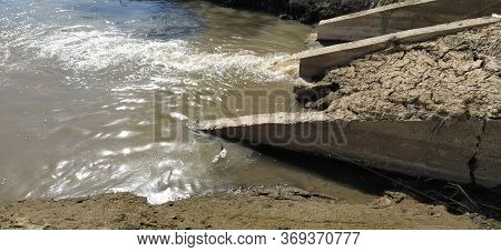 A Large City Drain Drains Sewage Into A Canal That Flows Into The River. Ecological Problem. The Con