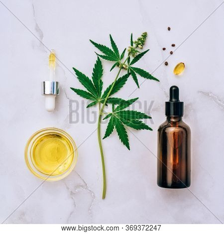 Medical Marijuana Cannabis Cbd Oil. Cbd Oil Hemp Products. Macro Detail Of Dropper With Cbd Oil, Can