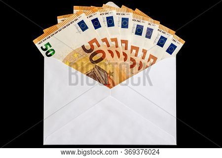 White Letter Envelope With Fifty Euro Notes On Black Background. High Quality Photo