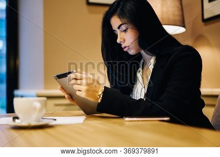 Successful Female Entrepreneur Using Touchpad For Checking Email Box In Application