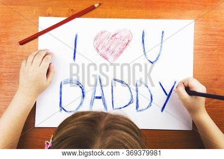 Fathers Day Concept. Girls Hands Drawing Card With Words I Love U Daddy, And Red Heart, And Color Pe