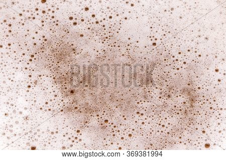 Top View Of Glass Of Cold Beer With Macro Detail Of Froth Bubbles