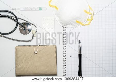 Medical Masks With Elastic Band, Thermometer, Medicine And Stethoscope, Isolated On White Background