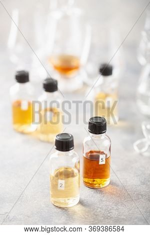 tasting whisky bottles and glasses or spirit brandy cognac. tasting at home