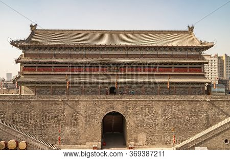 Xian, China - April 30, 2010: North Gate Of Huancheng City Wall. Main Palace Building With Red Decor