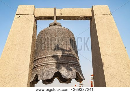 Xian, China - April 30, 2010: North Gate Of Huancheng City Wall. Giant War Bell On Display Above Gat