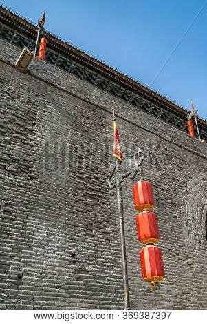 Xian, China - April 30, 2010: North Gate Of Huancheng City Wall. Red Lanterns On Dark Metal Decorate