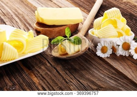 Butter Swirls. Margarine Or Spread, Fatty Natural Dairy Product. High-calorie Food For Cooking And D