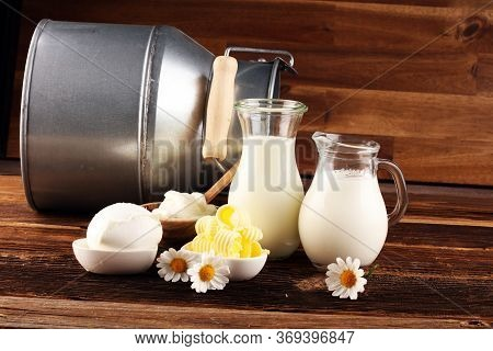 Milk Products. Tasty Healthy Dairy Products On A Table On. Mozzarella In A Bowl, Cottage Cheese Bowl