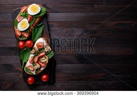 Bruschettas With Eggs, Vegetables And Mushrooms. Homemade Italian Appetizer, Healthy Snack, Traditio