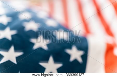 Patriotic holiday. The USA are celebrating 4th of July. American flag close up.