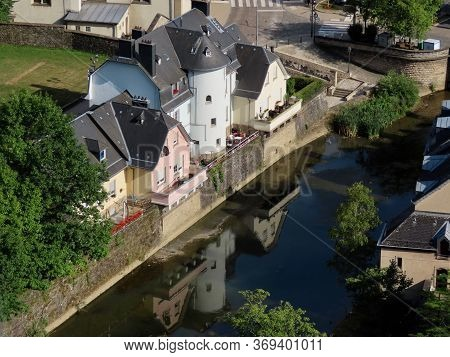 Luxembourg, Luxembourg - July 10, 2019. Old Medieval Buildings Reflecting In Waters Of Alzette River
