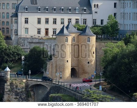 Luxembourg, Luxembourg - July 10, 2019. Three Towers Medieval Fortification Gate And Small Spanish T