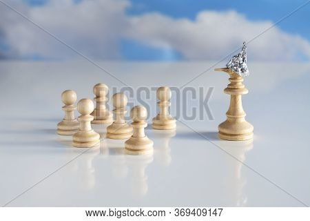 Chess Piece King Or Queen With Tin Foil Helmet On The Head And A Long Lying Nose Stands In Front Of
