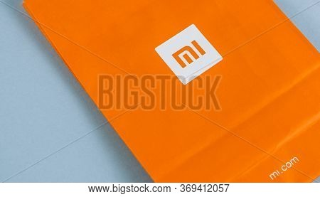 Xiaomi Logo On An Orange Background. High Quality Photo.